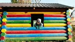 Child baby boy kid toddler playing in colorful house in the playground  Arkistovideo