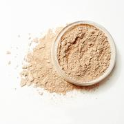 crumbled natural powder with package on white background - stock photo