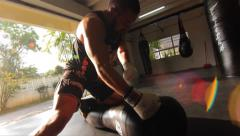 MMA Fighter Boxing Punch Heavy Bag Ground & Pound Sunlight Lens Flare Hand Held Stock Footage