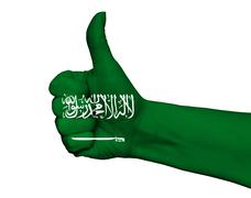Hand with thumb up painted in colors of Saudi Arabia flag isolated Stock Photos