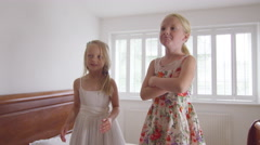 4K 2 Little girls having fun at home, playing in the bedroom with bubbles - stock footage