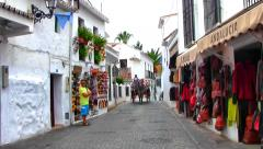 Streets of Mijas with horse carriage, Spain Stock Footage