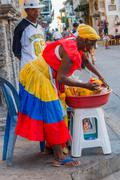 Afrocaribbean woman selling fresh choped fruit in the streets of Cartagena de Stock Photos