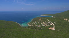 Aerial - Panoramic shot of a camping place at the coastal bay Stock Footage
