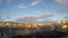 Central Europe town plunging into night (eastview during sunset); time-lapse - stock footage