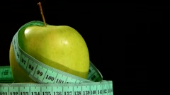 Green, fresh apple with measuring tape on white, rotation, reflection, close up Stock Footage