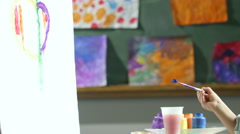 5 year old girl painting a picture Stock Footage