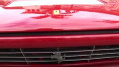 Red Ferrari Dino front boom down to horse Stock Footage