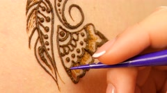 Going on of drawing process of henna mehendi ornament on back Stock Footage