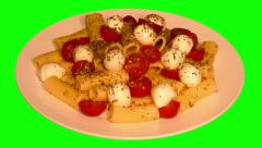 4k – Macaroni tubes with mozzarella, cherry tomatoes and spices on plate Stock Footage