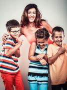 Happy smiling family kids little girl and boys. Stock Photos