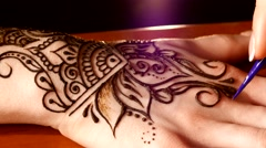 Womans hand decorated with mehendi, on black background Stock Footage