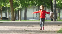 Cute little girl outside in nature on a summer day. Slow motion Stock Footage