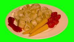 4k – Meat dumplings with vegetables on plate Stock Footage