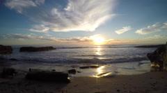 4K AERIAL: Beach Rocks Waves Sunset Landscape Stock Footage