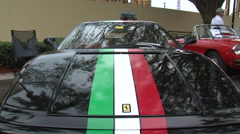 Ferrari race car tilt down to grill and horse Stock Footage