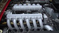 Ferrari V12 engine zoom out Stock Footage