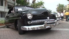 Mercury Eight vintage car wide shot handheld boom up Stock Footage
