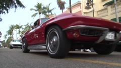 2 vintage Corvettes 427 V8 drive by Stock Footage