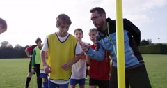 Soccer coach psyching up a young player during training session.Shot on RED Epic Stock Footage