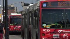 Ottawa city bus drives along road, Canada Arkistovideo