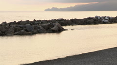 View of the promontory of Portofino from the beach in Chiavari at sunset - stock footage