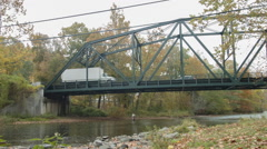 Fisherman in River, old New England Bridge with Traffic, Sportsman Stock Footage