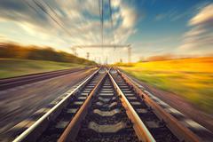 Cargo train platform at sunset. Railroad. Railway station - stock photo