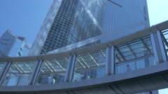 Walking people on skywalk in central business district of Hong Kong. Stock Footage