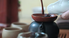 Measuring out tea leaves. Brewing tea in a teapot. Tea ceremony, close up - stock footage