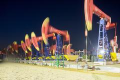 Landscape of oilfield at night Kuvituskuvat