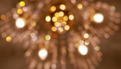 chandelier lighting in room, bokeh glint glare glow - stock footage