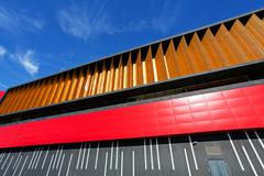 colorful aluminum facade on large shopping mall - stock photo