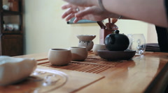 Master of tea doing traditional chinese tea ceremony on the table, slow motion Stock Footage