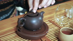 Master of tea doing tea ceremony on the table, close up Stock Footage