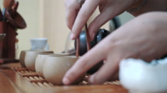 Warming up tea pot during traditional chinese tea ceremony, slow motion - stock footage