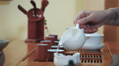 Warming up pialas for traditional chinese tea ceremony, close up, rack focus Stock Footage