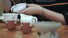 Measuring out tea leaves. Brewing tea in a teapot. Tea ceremony, dolly Stock Footage