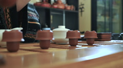 Master of tea doing traditional chinese tea ceremony on the table Stock Footage