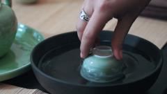 Master of tea warm up piala for tea ceremony, slow motion, close up Stock Footage