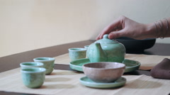 Master of tea doing traditional tea ceremony Stock Footage