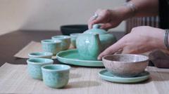 Master of tea pouring tea in pialas, rack focus, close up Stock Footage