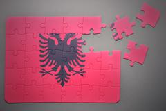 puzzle with the national flag of albania - stock photo