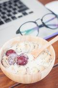 Granola with fruits on work station - stock photo