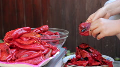 Peeling Roasted Red Peppers, CloseUp Stock Footage