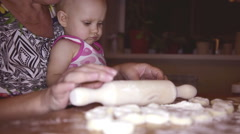 Preparing dough to make a varenik with assistant Stock Footage