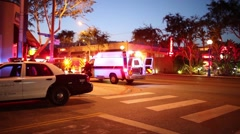 Cinemagraph - Flashing lights of ambulance car city street at night Motion Photo Stock Footage