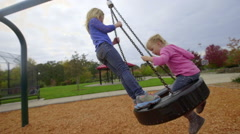 Big sisters gives little sister a ride Stock Footage