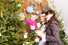 Stock Photo of Christmas Family Portrait In Home, House Decorating By Xmas Tree