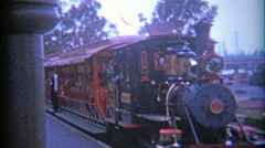 1966: Disneyland railroad train with conductor keeping a steady watchful eye. - stock footage